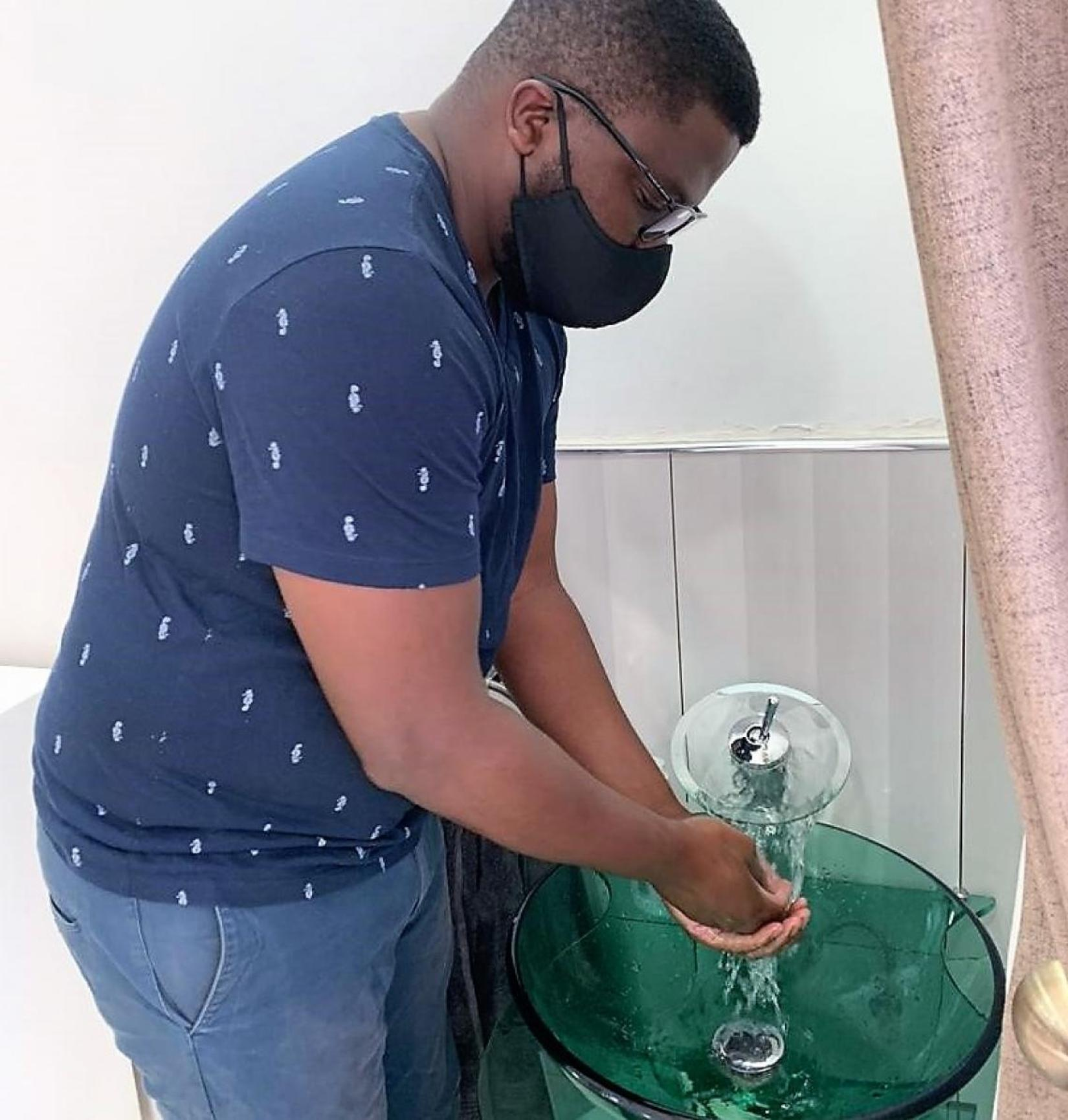 Rodrick handwashing at home, this is one of the preventative measures he has enhanced at home.